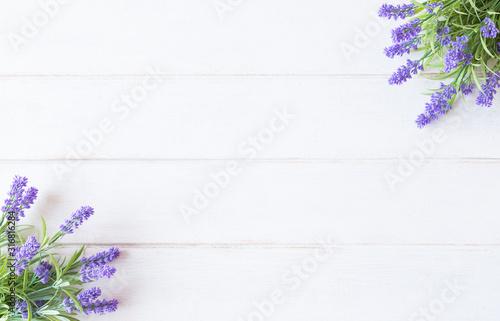 Fototapeta deski  violet-flowers-of-lavender-top-view-on-white-wooden-background
