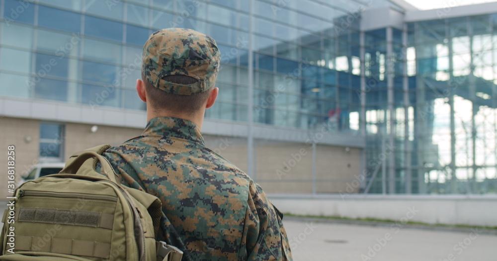 Fototapeta Back view of male soldier.