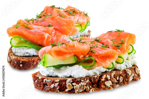 Fotografiet Smoked salmon ricotta cheese  rye sandwich on a white isolated background