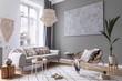 Leinwandbild Motiv Modern boho interior design of living room with design rattan armchair, gray sofa, coffee table, beige macrame, plants and elegant accessories. Stylish home decor. Abstract paintings. Template.