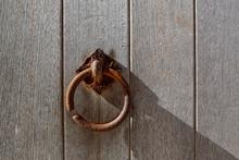 Rusty Knocker On Wooden Door