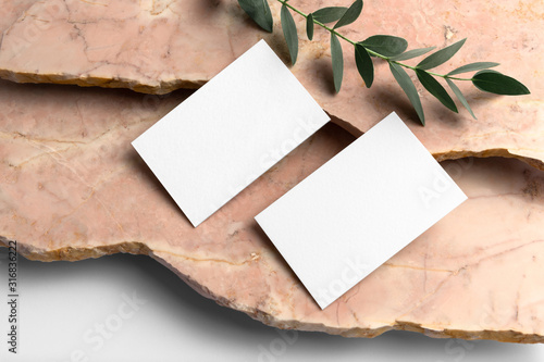 Obraz Real photo, business cards branding mockup template, isolated on light grey background, with marble and floral elements to place your design. - fototapety do salonu