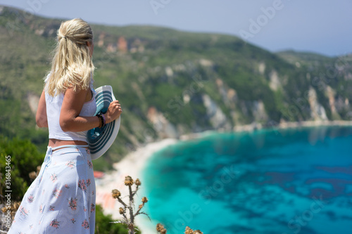 Blonde girl in front of Petani beach on Kefalonia island admiring highly excited seascape Canvas Print