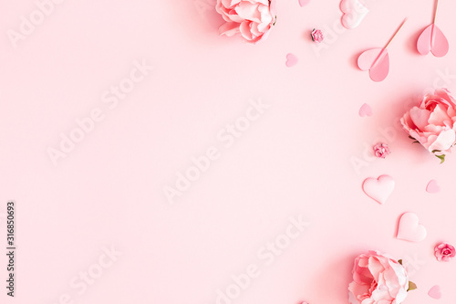 Valentine's Day background. Pink flowers, envelope, hearts on pastel pink background. Valentines day concept. Flat lay, top view, copy space - 316850693