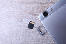 Flash Memory Data Storage Concept : A Tray With A Micro SD Card On White Background. A Memory Card Is Used For Storing Digital Information In Portable Electronic Devices E.g Mobile Phone, Tablets, Etc