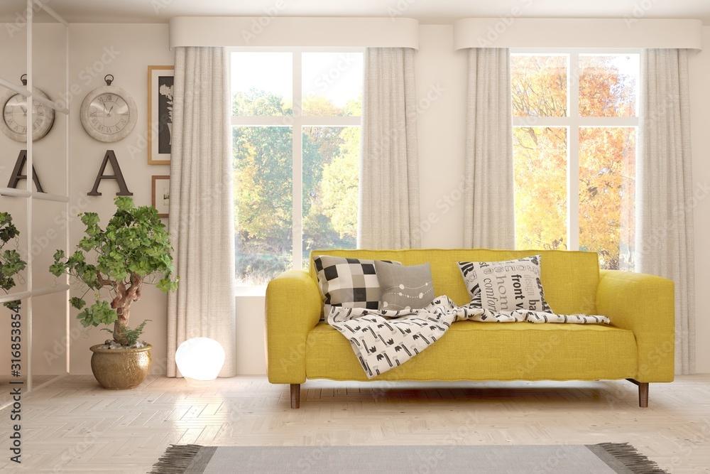 Fototapeta Stylish room in white color with sofa and autumn landscape in window. Scandinavian interior design. 3D illustration