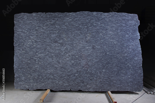 Fotografie, Obraz A large slab of natural stone in blue is called granite Orissa Blue