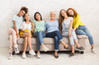 canvas print picture - Women Of Different Age Sitting On Sofa Smiling Indoor