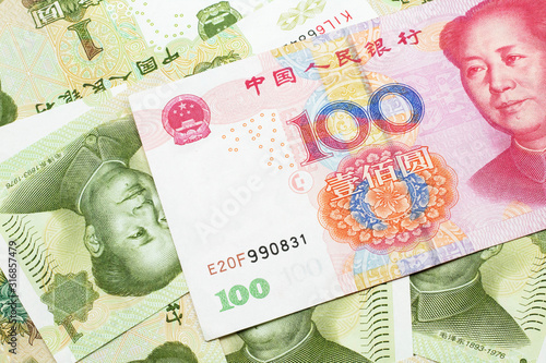 A close up image of a red, one hundred Chinese yuan bank note, close up on a background of green one yuan bank notes Tapéta, Fotótapéta