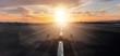 Leinwandbild Motiv Empty airplane runway with dramatic sunset