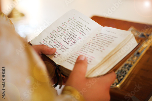 Obraz na plátně The Bible is in the hands of a priest, a holy father