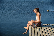 Beautiful Woman Sitting On The...