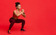 Happy Black Girl Enjoying Working Out Over Red Background