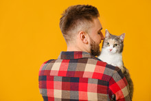 Man With Cute Cat On Color Bac...