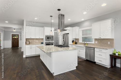 Cuadros en Lienzo Beautiful kitchen in new home, with stainless steel appliances