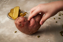 Ugly Food, Potatoes In The Shape Of A Heart. Natural And Simple Farm Products. Salted Fermented Cucumbers. Pumpkin Seeds. Children's Hands Hold Potatoes, Taking Care Of The Crop.