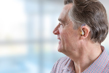 Head Of A Senior Man With Hearing Aid In His Ear