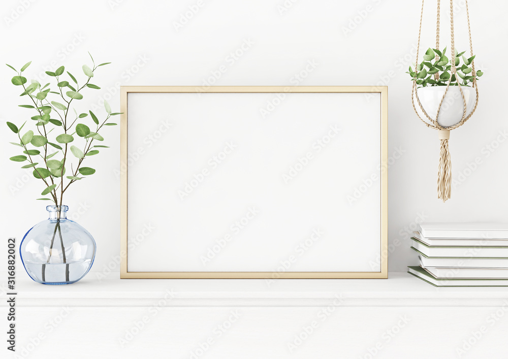 Fototapeta Interior poster mockup with horizontal gold metal frame on the table with plants in blue vase and hanging macrame pot on empty white wall background. A4, A3 size format. 3D rendering, illustration.