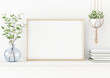 canvas print picture - Interior poster mockup with horizontal gold metal frame on the table with plants in blue vase and hanging macrame pot on empty white wall background. A4, A3 size format. 3D rendering, illustration.