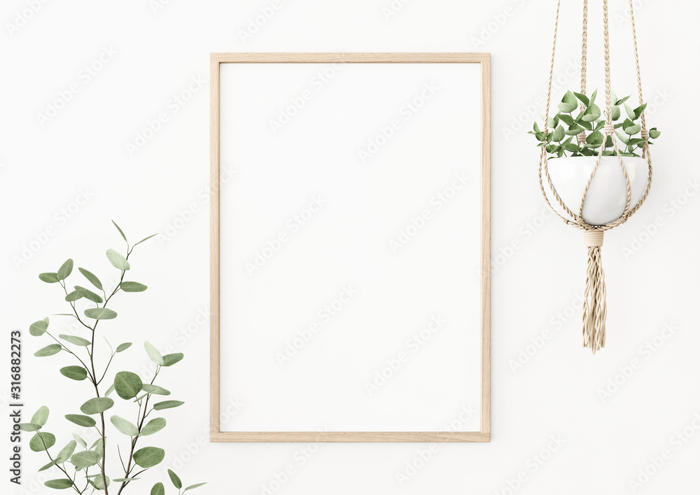 Fototapeta Interior poster mockup with vertical wooden frame on empty white wall decorated with plant branch and hanging macrame pot. A4, A3 size format. 3D rendering, illustration.