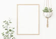 Leinwanddruck Bild - Interior poster mockup with vertical wooden frame on empty white wall decorated with plant branch and hanging macrame pot. A4, A3 size format. 3D rendering, illustration.