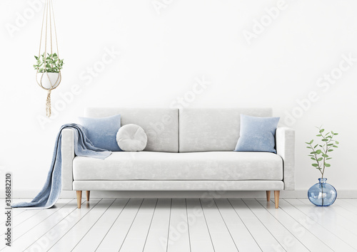 Fototapeta Living room interior wall mockup with gray velvet sofa, blue pillows, plaid, hanging plant and green branch in vase on empty white wall background. 3D rendering, illustration. obraz na płótnie