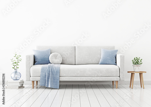 Living room interior wall mockup with gray velvet sofa, blue pillows and plaid, plant in vase and coffee table with pot on empty white wall background Obraz na płótnie