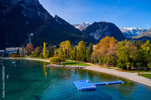 Beautiful and colorful autumn in Riva del Garda,Panorama of the gorgeous Garda l Canvas Print