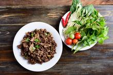 Northern Thai Food, Spicy Minced Pork Salad (Larb Moo Kua) Eating With Fresh Vegetables