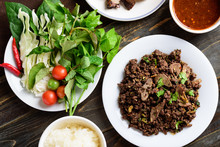 Northern Thai Food, Spicy Minced Pork Salad (Larb Moo Kua) Eating With Fresh Vegetables And Sticky Rice, Top View