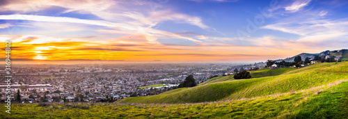 Photo Sunset view of residential and industrial areas in East San Francisco Bay Area;