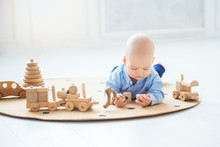 Baby Boy Playing With Wooden T...