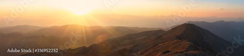 Fototapeta Panorama of the mountains at sunset. obraz