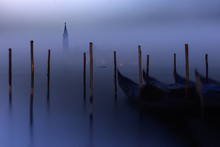 Bell Tower In Foggy Winter At Venetian Lagoon