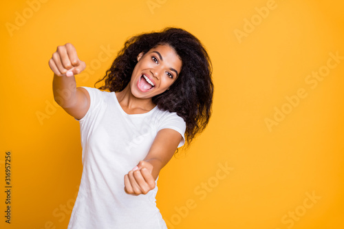 Obraz Portrait of her she nice attractive lovely charming cheerful cheery funny wavy-haired girl driving invisible rudder helm isolated over bright vivid shine vibrant yellow color background - fototapety do salonu