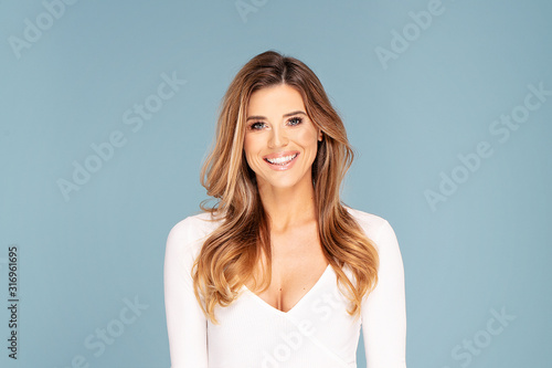 Obraz Beauty photo of happy smiling woman. - fototapety do salonu