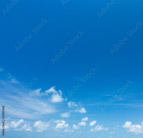 Blue sky background with tiny clouds. clouds in the blue sky Wall mural
