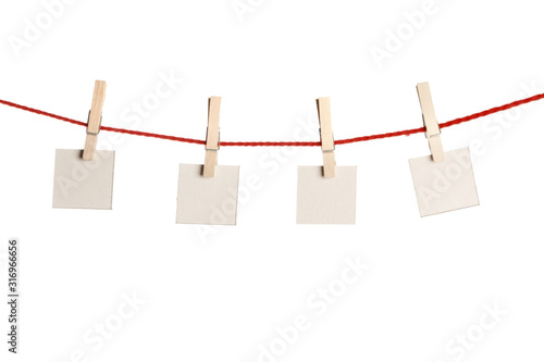 Fotografía Set of blank notes held on string isolated