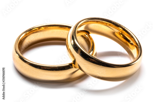 Fotografia, Obraz Gold wedding rings on white