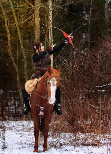 a Viking girl riding a red horse painted in black runes Canvas Print