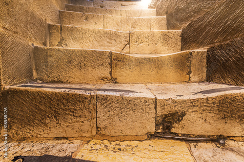 Tablou Canvas Heavily worn steps of a stairs in Church o a Holy Sepulchre, Jerusalem