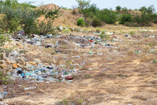 Landfill And Plastic Waste At Nature Landscape