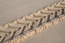 Car Tracks In The Sand Footprint Left By Passage Of Tractor On Desert Beach