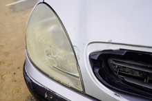 Unpolished Cloudy Foggy Front Plastic Car Headlight Of Old In Worn Cleaning Concept