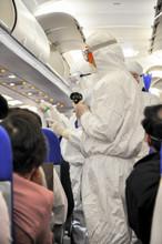 Medics In White Hazmat Protect...