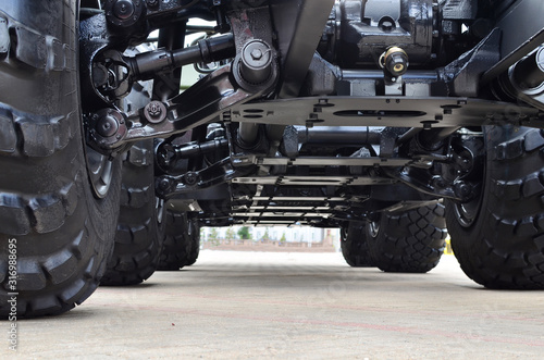 Photo Lightweight fixed frame air suspension, air springs and shock absorbers on wheels with tyres