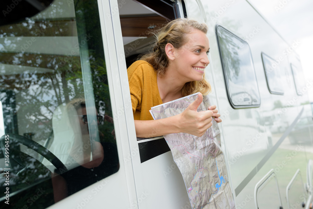 Fototapeta a cheerful beautiful woman minivan