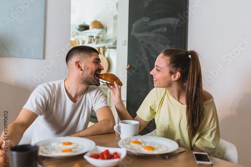 Fototapeta romantic couple eating breakfast at home obraz