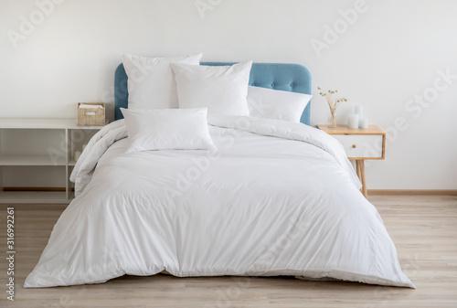 Interior with white bed linen on the sofa Fototapeta