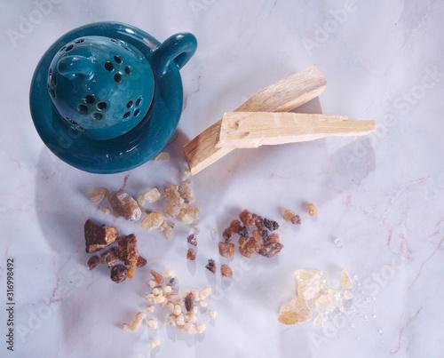 Valokuvatapetti Natural incense: resin and palo santo and censer.